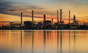 petrochemical plant in night time with reflection over the river