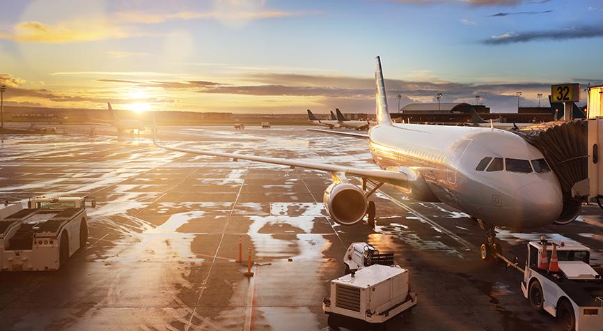 Airplane at terminal gate in international airport